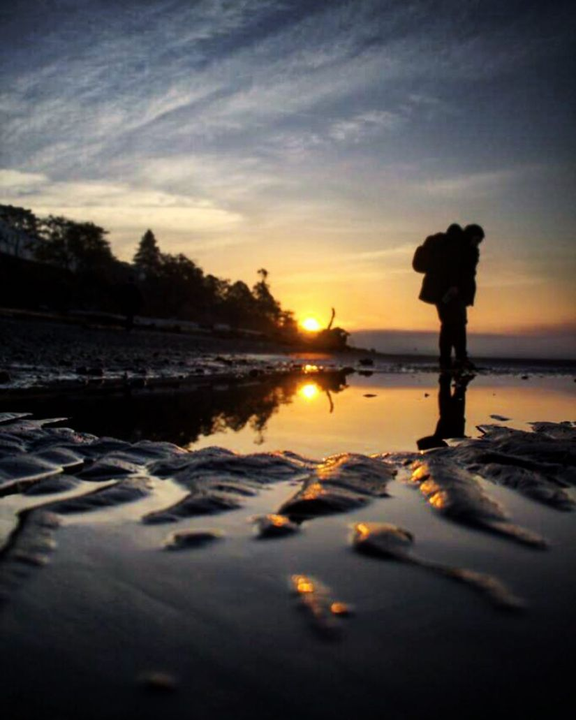 bokeh-white-rock-silhouette-figure-beach