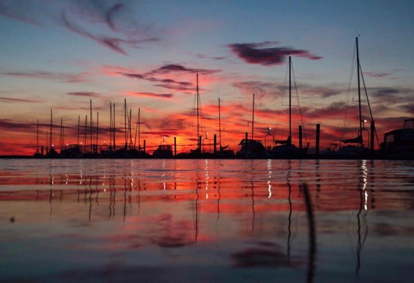 beach-crescent-calming-sunset-sailboats-